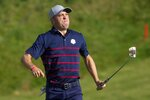 Team USA's Justin Thomas reacts to his birdie putt during a four-ball match the Ryder Cup at the Whistling Straits Golf Course Friday, Sept. 24, 2021, in Sheboygan, Wis. (AP Photo/Charlie Neibergall)