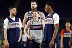 Virginia's Kyle Guy (5) laughs as he gather with Ty Jerome (11), Jay Huff (30) and De'Andre Hunter (12) during a practice session for the semifinals of the Final Four NCAA college basketball tournament, Friday, April 5, 2019, in Minneapolis. (AP Photo/Charlie Neibergall)