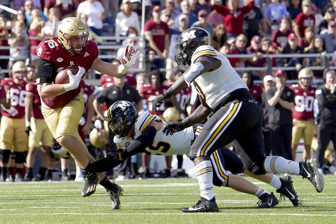 Boston College tight end Joey Luchetti (16) rushes ahead of Missouri linebacker Blaze Alldredge (25) and Akial Byers (0) during the second half of an NCAA college football game, Saturday, Sept. 25, 2021, in Boston. (AP Photo/Mary Schwalm)