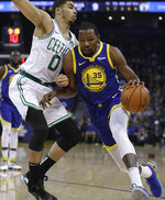 Golden State Warriors' Kevin Durant, right, drives the ball against Boston Celtics' Jayson Tatum during the first half of an NBA basketball game Tuesday, March 5, 2019, in Oakland, Calif. (AP Photo/Ben Margot)