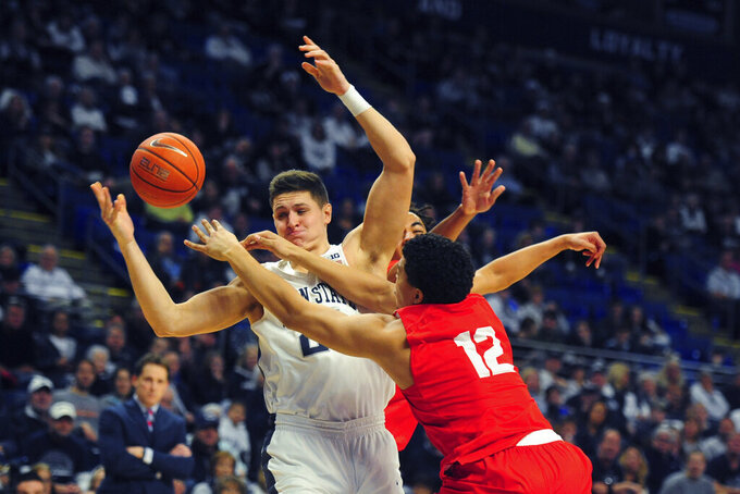 Penn State's John Harrar (21) and Cornell's Kobe Dickson (12) collide in first half action of an NCAA college basketball game, Sunday, Dec. 29, 2019, in State College, Pa. (AP Photo/Gary M. Baranec)