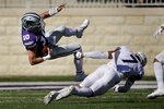 Kansas State quarterback Skylar Thompson (10) is tackled by TCU safety Trevon Moehrig (7) as he runs for a first down during the first half of an NCAA college football game Saturday, Oct. 19, 2019, in Manhattan, Kan. (AP Photo/Charlie Riedel)