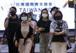 People wear face masks to protect against the spread of the coronavirus after the COVID-19 alert raise to level 3 in Taipei, Taiwan, Thursday, July 8, 2021. (AP Photo/Chiang Ying-ying)