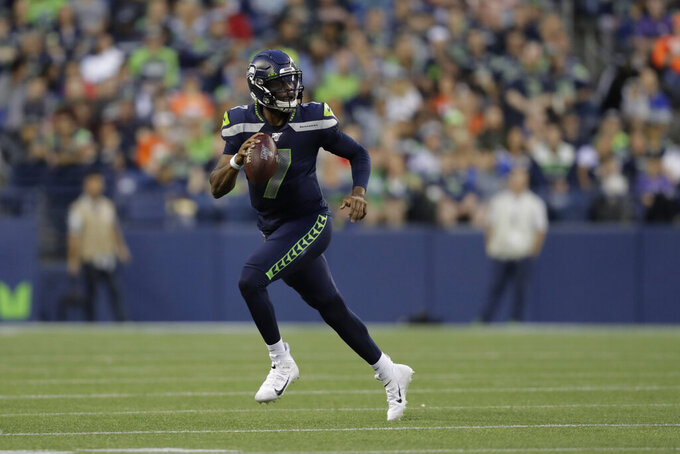 Seattle Seahawks quarterback Geno Smith looks to pass against the Denver Broncos during the first half of an NFL football preseason game Thursday, Aug. 8, 2019, in Seattle. (AP Photo/Stephen Brashear)