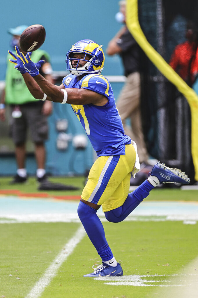 Los Angeles Rams wide receiver Robert Woods (17) catches a pass during warm-ups prior to an NFL game against the Miami Dolphins, Sunday, Nov. 1, 2020 in Miami Gardens, Fla. The Dolphins defeated the Rams 28-17. (Margaret Bowles via AP)