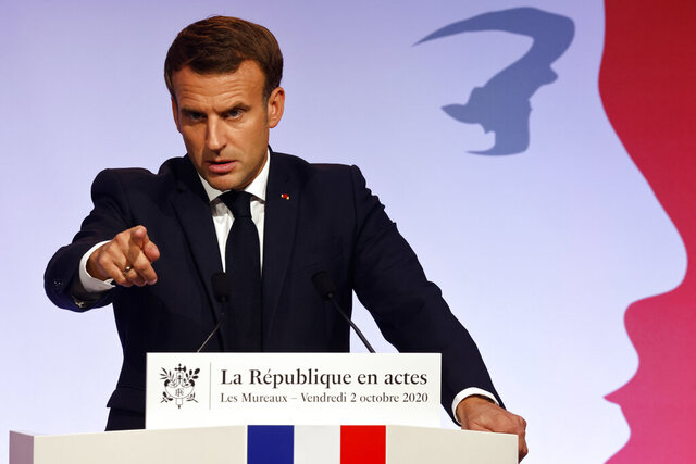French President Emmanuel Macron delivers a speech to present his strategy to fight separatism, Friday Oct. 2, 2020 in Les Mureaux, outside Paris. President Emmanuel Macron, trying to rid France of what authorities say is a