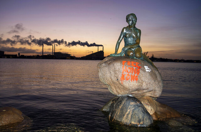 "The Little Mermaid statue with graffiti, in Copenhagen on Monday, January 13, 2020. Copenhagen's famed Little Mermaid statue was found doused with graffiti early Monday with three lines in red, reading ""Free Hong-Kong"" scribbled on the rock on which the bronze sits, next to the same text in white. (Thomas Sjoerup/Ritzau Scanpix via AP)"