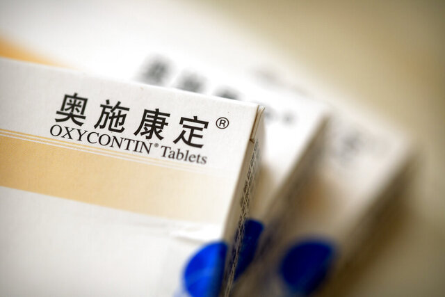 Boxes of OxyContin tablets sold in China sit on a table in southern China's Hunan province on Sept. 24, 2019. Representatives from the Sacklers' Chinese affiliate, Mundipharma, tell doctors that OxyContin is less addictive than other opioids — the same pitch that their U.S. company, Purdue Pharma, admitted was false in court more than a decade ago. (AP Photo/Mark Schiefelbein)