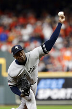 New York Yankees relief pitcher Aroldis Chapman throws against the Houston Astros during the ninth inning in Game 2 of baseball's American League Championship Series Sunday, Oct. 13, 2019, in Houston. (AP Photo/Eric Gay)