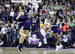 FILE - In this April 1, 2018, file photo, Notre Dame's Arike Ogunbowale (24) celebrates with teammates after making a 3-point basket to defeat Mississippi State 61-58 in the final of the women's NCAA Final Four college basketball tournament in Columbus, Ohio. (AP Photo/Ron Schwane, File)