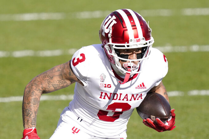 FILE — In this Nov. 14, 2020, file photo, Indiana wide receiver Ty Fryfogle plays during the first half of an NCAA college football game, in East Lansing, Mich. Fryfogle is returning for his fifth season this fall. (AP Photo/Carlos Osorio, File)