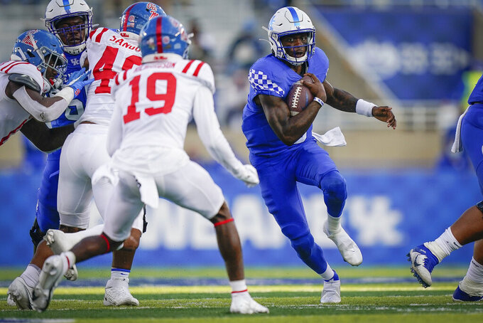 Kentucky quarterback Terry Wilson (3) scrambles with the ball during the second half of an NCAA college football game against Mississippi, Saturday, Oct. 3, 2020, in Lexington, Ky. (AP Photo/Bryan Woolston)