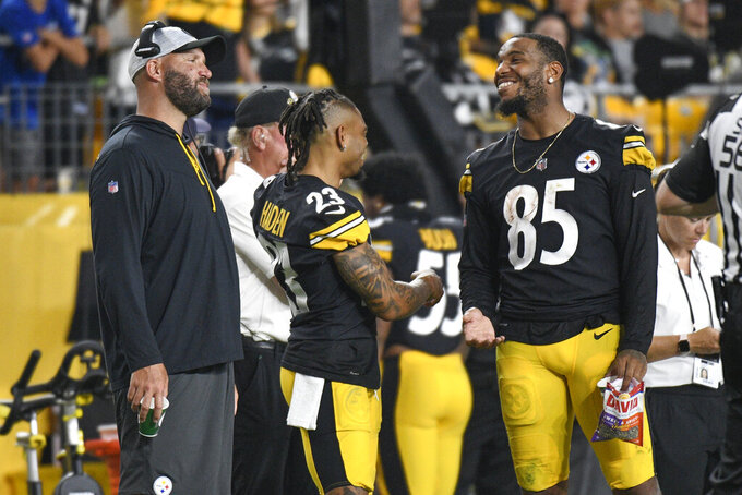 Pittsburgh Steelers quarterback Ben Roethlisberger, left, and tight end Eric Ebron (85) smile on the sideline as the team plays the Detroit Lions during the second half of an NFL preseason football game Saturday, Aug. 21, 2021, in Pittsburgh. (AP Photo/Don Wright)