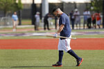 Houston Astros' Jose Altuve carries a bat as he heads out to hit during spring training baseball practice Thursday, Feb. 13, 2020, in West Palm Beach, Fla. (AP Photo/Jeff Roberson)