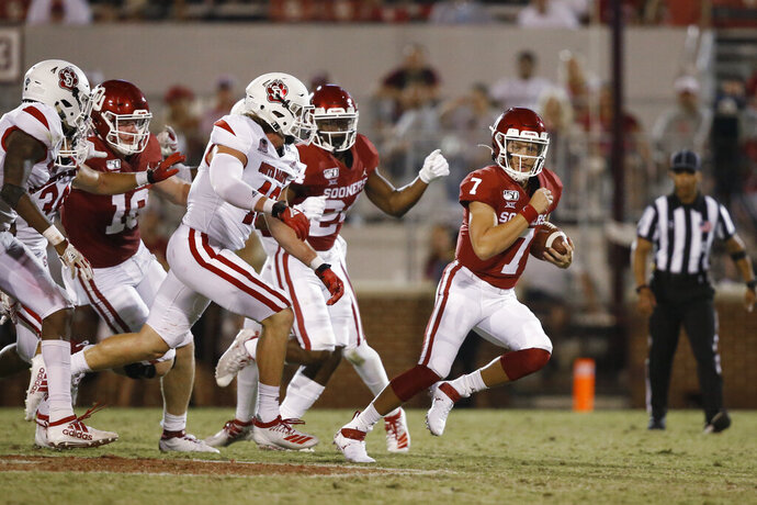 FILE - In this Sept. 7, 2019 file photo, Oklahoma quarterback Spencer Rattler (7) carries in the fourth quarter of an NCAA college football game against South Dakota, in Norman, Okla. The coronavirus pandemic has shut down much of Division I football, but with three of the Power Five leagues still playing, there are still some big games to look forward to. Oklahoma takes on Texas on Oct. 10, 2020. (AP Photo/Sue Ogrocki, File)