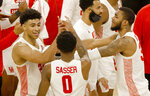 Houston's Quentin Grimes (24), Marcus Sasser (0) and Fabian White Jr. (35) celebrate following the team's win over Memphis in an NCAA college basketball game in the semifinal round of the American Athletic Conference men's tournament Saturday, March 13, 2021, in Fort Worth, Texas. (AP Photo/Ron Jenkins)