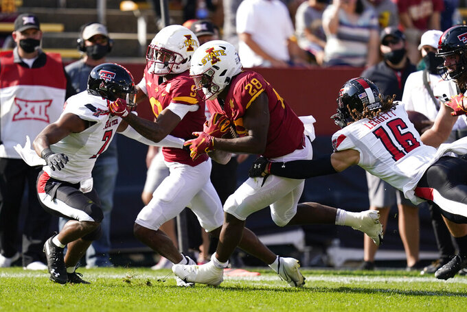 Iowa State running back Breece Hall (28) breaks a tackle by Texas Tech defensive back Thomas Leggett (16) during an 11-yard touchdown run in the first half of an NCAA college football game, Saturday, Oct. 10, 2020, in Ames, Iowa. (AP Photo/Charlie Neibergall)