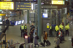 Dutch police mill about after a threat at Schiphol airport in Amsterdam, Netherlands, Wednesday, Nov. 6, 2019. Dutch military police say that all passengers and crew are safely off a plane at the center of a security alert at Amsterdam's Schiphol Airport. The military police service earlier said they were responding to a suspicious situation at the airport on the outskirts of Amsterdam. (AP Photo/Peter Dejong)