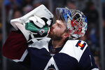 Colorado Avalanche goaltender Semyon Varlamov takes a drink during a time out against the St. Louis Blues in the second period of an NHL hockey game Saturday, Feb. 16, 2019, in Denver. (AP Photo/David Zalubowski)