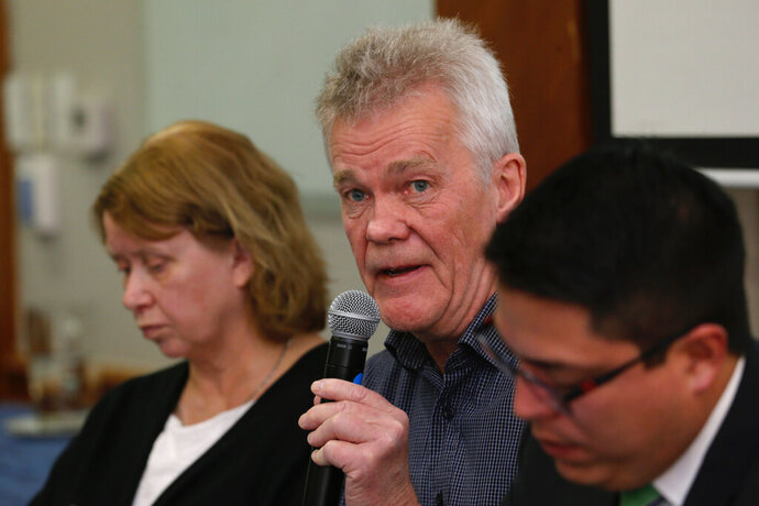 The father of detained Swedish programmer Ola Bini, Dag Gustafsson, speaks at a press conference flanked by his wife Gorel Bini, and his son's lawyer Carlos Soria, in Quito, Ecuador, Tuesday, April 16, 2019. The ace Swedish programmer who was an early, ardent supporter of WikiLeaks was arrested in Ecuador last week in an alleged plot to blackmail the country's president over his abandonment of Julian Assange. (AP Photo/Dolores Ochoa)