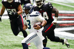 Seattle Seahawks quarterback Russell Wilson (3) runs for a first down against the Atlanta Falcons during the first half of an NFL football game, Sunday, Sept. 13, 2020, in Atlanta. (AP Photo/John Bazemore)