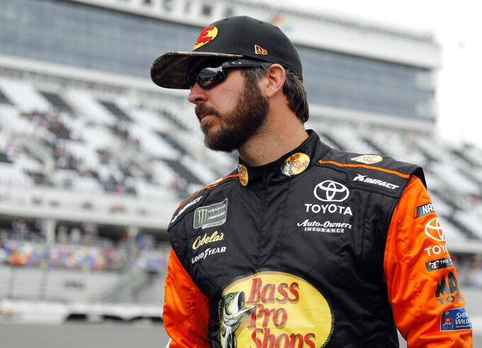 Martin Truex Jr. looks at cars on the track before his turn during qualifying for the Daytona 500 auto race at Daytona International Speedway, Sunday, Feb. 10, 2019, in Daytona Beach, Fla. (AP Photo/Terry Renna)