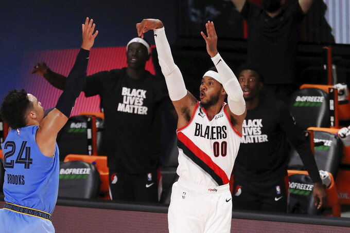 Portland Trail Blazers' Carmelo Anthony (00) shoots a three-point basket during the second half of an NBA basketball game against the Memphis Grizzlies, Friday, July 31, 2020, in Lake Buena Vista, Fla. (Mike Ehrmann/Pool Photo via AP)
