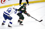 Minnesota Wild's Zach Parise (11) tries to control the puck the puck against Tampa Bay Lightning's Jan Rutta (44), of the Czech Republic, during the first period of an NHL hockey game Thursday, Jan. 16, 2020, in St. Paul, Minn. (AP Photo/Hannah Foslien)