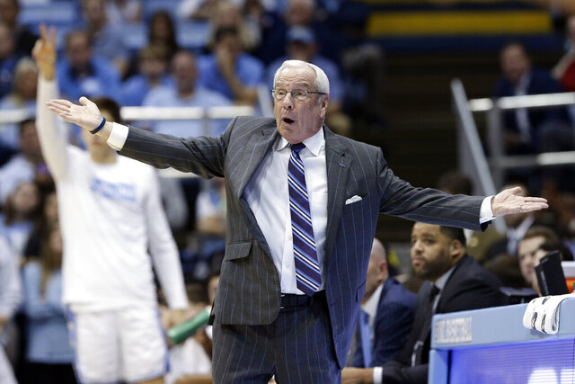 North Carolina coach Roy Williams reacts during the first half of the team's NCAA college basketball game against Georgia Tech in Chapel Hill, N.C., Saturday, Jan. 4, 2020. (AP Photo/Gerry Broome)