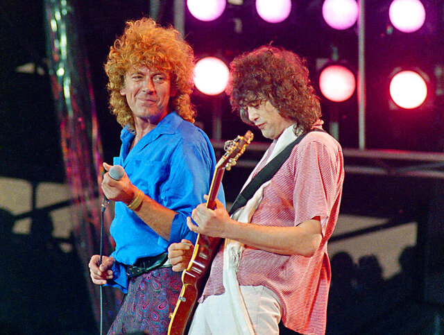 "FILE - In this July 13, 1985 file photo, Led Zeppelin bandmates, singer Robert Plant, left, and guitarist Jimmy Page, reunite to perform for the Live Aid famine relief concert at JFK Stadium in Philadelphia. From left are John Bonham, Robert Plant, Denny and Jimmy Page. A federal appeals court on Monday, March 9, 2020, restored a jury verdict that found Led Zeppelin did not steal ""Stairway to Heaven."