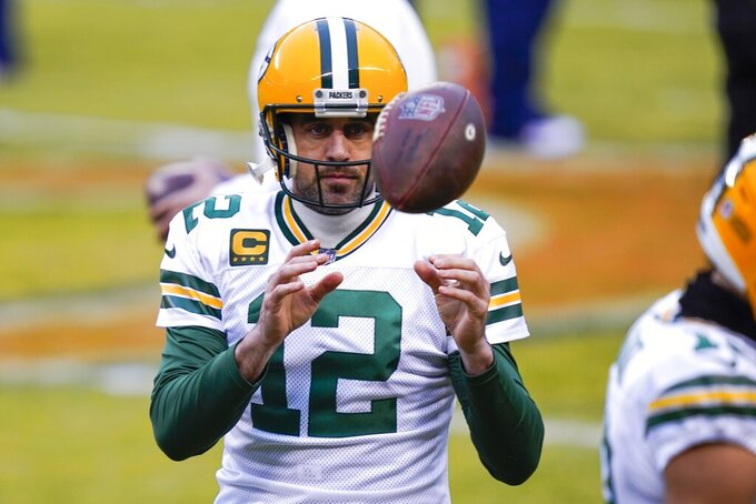 Green Bay Packers' Aaron Rodgers warms up before an NFL football game against the Chicago Bears Sunday, Jan. 3, 2021, in Chicago. (AP Photo/Charles Rex Arbogast)