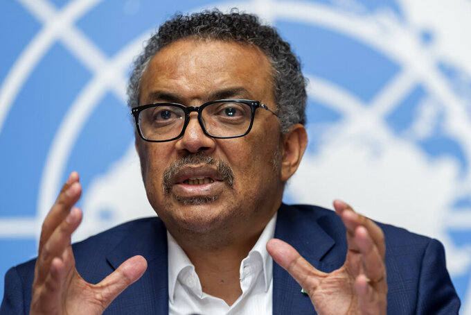 FILE-In this March 14, 2019 file photo Tedros Adhanom Ghebreyesus, Director-General of the World Health Organization (WHO), speaks at the European headquarters of the United Nations in Geneva, Switzerland. The World Health Organization's director-general has faced many challenges during the coronavirus pandemic: racial slurs, death threats, social media caricatures — he was once depicted as a ventriloquist's dummy in the hands of Chinese President Xi Jinping — and U.S. funding cuts. (Martial Trezzini/Keystone via AP)