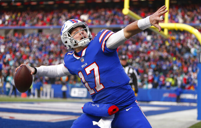 FILE - In this Dec. 30, 2018, file photo, Buffalo Bills quarterback Josh Allen celebrates his touchdown during the second half of an NFL football game against the Miami Dolphins in Orchard Park, N.Y.  Allen took it upon himself to be the Bills' one-man welcome committee in sending a text to each of the Bills' numerous free agent additions last month. (AP Photo/Jeffrey T. Barnes, File)