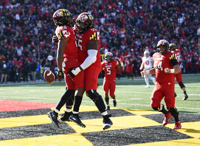FILE - In this Saturday, Nov. 17, 2018, file photo, Maryland running back Javon Leake (20) celebrates his touchdown with offensive linemen Derwin Gray (55) and Spencer Anderson (54) during the first half of an NCAA football game against Ohio State in College Park, Md. No matter how Maryland fares in the regular season finale against No. 15 Penn State, it won't change the pride that interim coach Matt Canada feels about the way his players have performed under extremely difficult circumstances. (AP Photo/Nick Wass, File)
