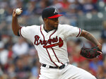 Atlanta Braves starting pitcher Julio Teheran (49) works against the New York Mets in the first inning of a baseball game Tuesday, June 18, 2019, in Atlanta. (AP Photo/John Bazemore)