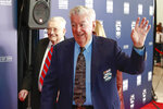Former NASCAR driver and hall of famer Bobby Allison waves as he arrives on the red carpet before the NASCAR Hall of Fame induction ceremony for the class of 2019, Friday, Feb. 1, 2019, in Charlotte, N.C. (AP Photo/Jason E. Miczek)