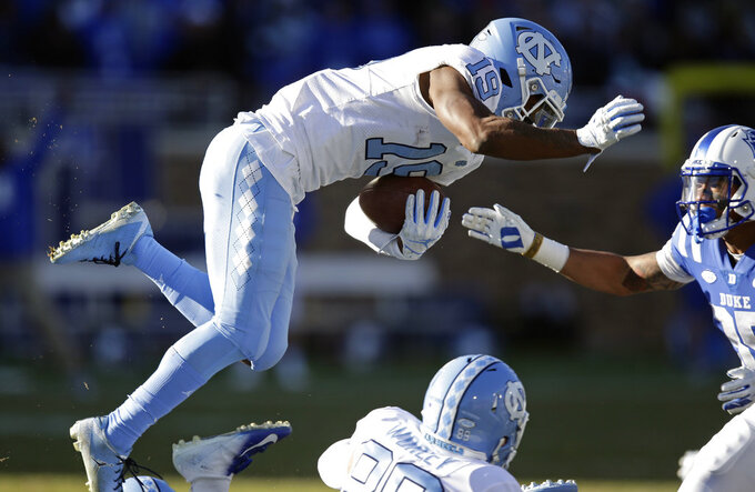 North Carolina's Dazz Newsome (19) leaps during the second half of an NCAA college football game against Duke in Durham, N.C., Saturday, Nov. 10, 2018. Duke won 42-35. (AP Photo/Gerry Broome)