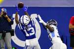 Indianapolis Colts wide receiver T.Y. Hilton (13) makes a catch for a touchdown in front of Tennessee Titans cornerback Breon Borders (39) in the second half of an NFL football game in Indianapolis, Sunday, Nov. 29, 2020. (AP Photo/Darron Cummings)