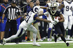 New Orleans Saints' Michael Thomas tries to get away from Los Angeles Rams' Aqib Talib during the first half the NFL football NFC championship game Sunday, Jan. 20, 2019, in New Orleans. (AP Photo/David J. Phillip)