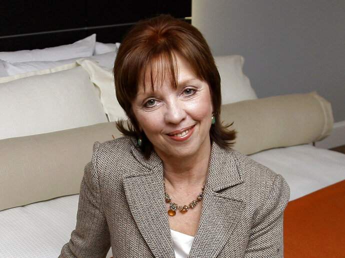 "FILE - This Feb. 13, 2009 file photo shows novelist Nora Roberts posing for a portrait in Boonsboro, Md. Roberts is suing a Brazilian writer for copyright infringement, alleging that Cristiane Serruya has committed ""multi-plagiarism."" In papers filed Wednesday, April 24, 2019, in Rio de Janeiro, Roberts alleged that Serruya's books showed an extraordinary level of verbatim lifting and close paraphrasing. Roberts would donate any damages from the suit to a non-profit literacy program in Brazil. (AP Photo/Rob Carr, File)"