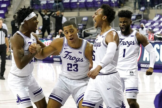 TCU's RJ Nembhard, left, Jaedon LeDee (23), Chuck O'Bannon Jr. (5) and Mike Miles (1) celebrate a basket by LeDee late in the second half of an NCAA college basketball game against Oklahoma State in Fort Worth, Texas, Wednesday, Feb. 3, 2021. TCU won 81-78. (AP Photo/Tony Gutierrez)