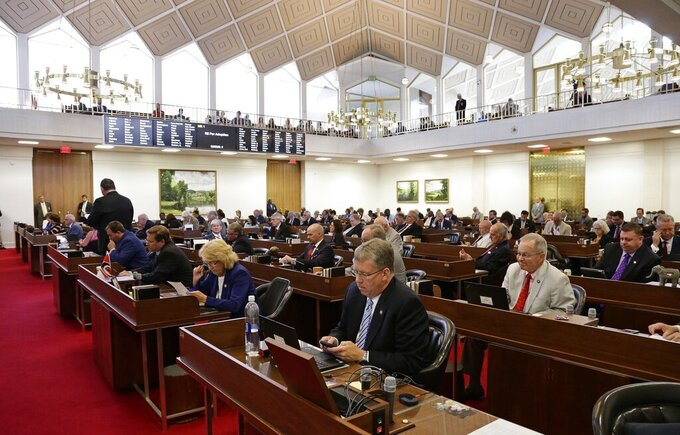 FILE - In this Tuesday, July 24, 2018, file photo, members of the North Carolina House gather for a special session at the General Assembly in Raleigh, N.C. (AP Photo/Gerry Broome, File)