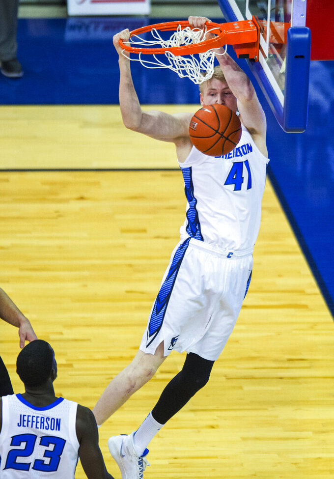 Creighton's Jacob Epperson dunks against Omaha during the first half of an NCAA college basketball game in Omaha, Neb., Tuesday, Dec. 1, 2020. (AP Photo/Kayla Wolf)