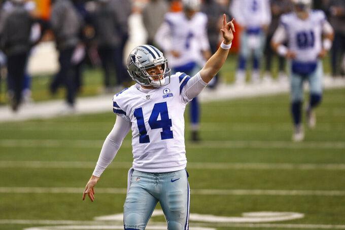 Dallas Cowboys quarterback Andy Dalton (14) celebrates a touchdown throw against the Cincinnati Bengals in the second half of an NFL football game in Cincinnati, Sunday, Dec. 13, 2020. (AP Photo/Aaron Doster)