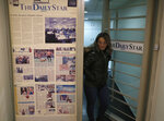 An employee of The Daily Star newspaper opens the main door of the newspaper office, in Beirut, Lebanon, Tuesday, Feb. 4, 2020. Lebanon's only English-language newspaper has announced that it's temporarily suspending its print edition because of financial challenges as the country passes through its worst economic crisis in decades. The Daily Star said on Tuesday that its website and social media platforms will continue work as usual. (AP Photo/Hussein Malla)