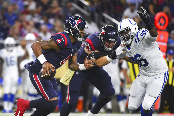 Houston Texans quarterback Deshaun Watson (4) is pressured by Indianapolis Colts defensive tackle Denico Autry (96) during the first half of an NFL football game Thursday, Nov. 21, 2019, in Houston. (AP Photo/Eric Christian Smith)