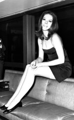 """FILE - In this Nov. 8, 1967 file photo, British actress Diana Rigg poses for photographers during a press conference at the Hilton Hotel, London. Actress Diana Rigg, who became a 1960s style icon as secret agent Emma Peel in TV series """"The Avengers,"""" has died at age 82. Rigg's agent Simon Beresford says she died Thursday Sept. 10, 2020 at home with her family. (AP Photo/Bob Dear, File)"""