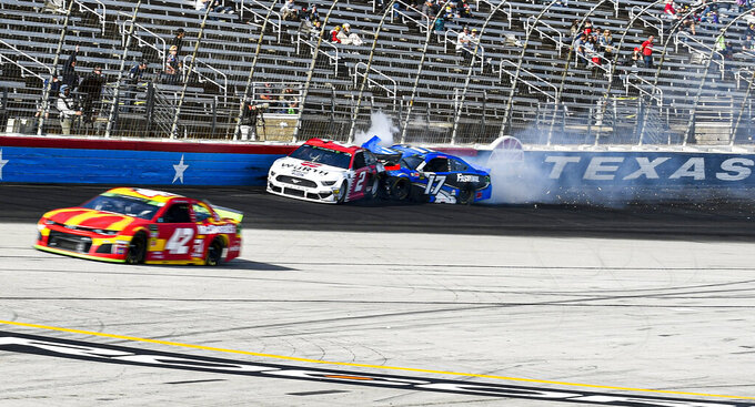 The Latest: Harvick wins at Texas again for another Cup shot