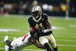 FILE - In this Sept. 9, 2018, file photo, New Orleans Saints running back Alvin Kamara (41) carries in the first half of an NFL football game against the Tampa Bay Buccaneers in New Orleans. Kamara, who had 112 yards receiving last week, said Saints quarterback Drew Brees' ability to read defenses will help against the blitz packages favored by Cleveland Browns coordinator Gregg Williams. (AP Photo/Butch Dill, File)