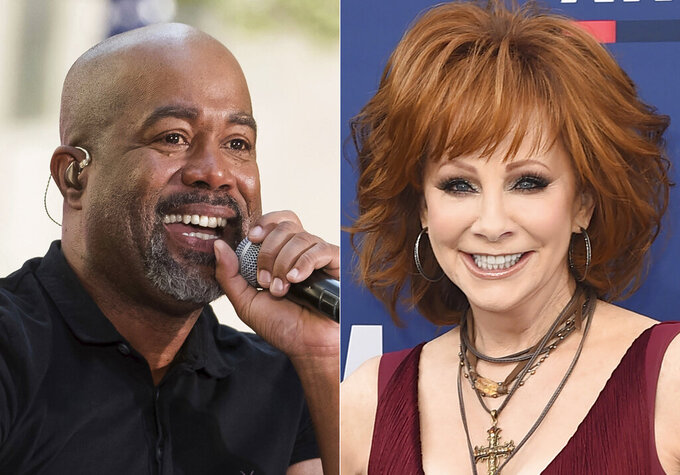 """This combination photo shows Darius Rucker performing on NBC's """"Today"""" show in New York on May 25, 2018, left, and Reba McEntire  at the 54th annual Academy of Country Music Awards in Las Vegas on April 7, 2019. McEntire and Rucker are promising laughs and good music when they co-host this year's CMA Awards in November. McEntire is a veteran of awards show hosting, while Rucker will be a first-time host when the show airs on Nov. 11 on ABC from Nashville, Tenn. (AP Photo)"""